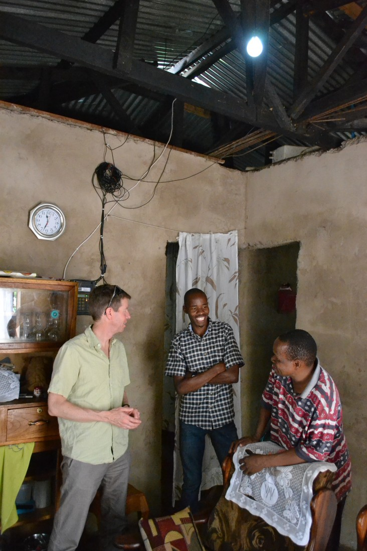 OPIC's Chief of Staff John Morton in the home of a customer of Off-Grid Electric's innovative pay-as-you-go home solar service.