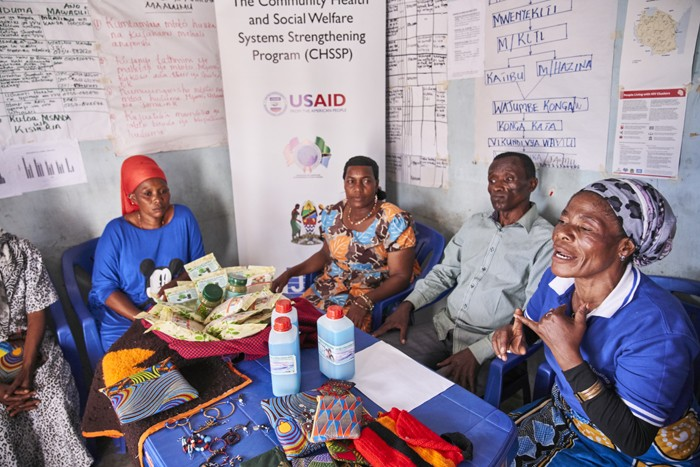 Jane Mwaliego (far right) leads her local group to support community members to get tested for HIV and, if found to be positive, to start and stay on treatment.