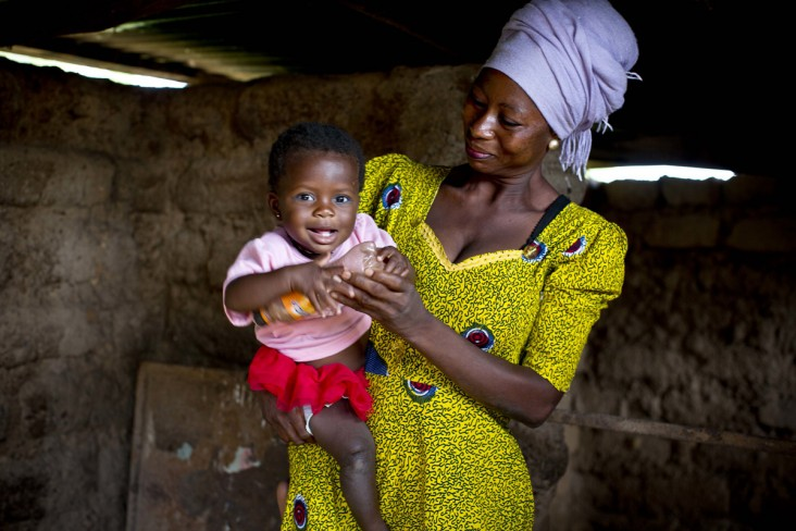 Rahama, 30, plays with her 9-month-old daughter, Maradiatu, inside their home in Sijri Veng Veng Village, Ghana.