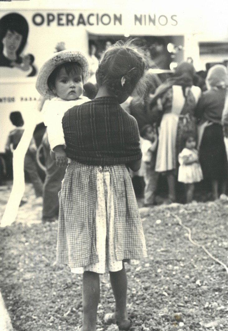 A historical photo of a woman holding a child