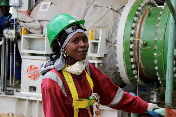 A worker inspects equipment at the Olkaria Geothermal Plant in Kenya. (Photo: Carole Douglis/USAID West Africa)