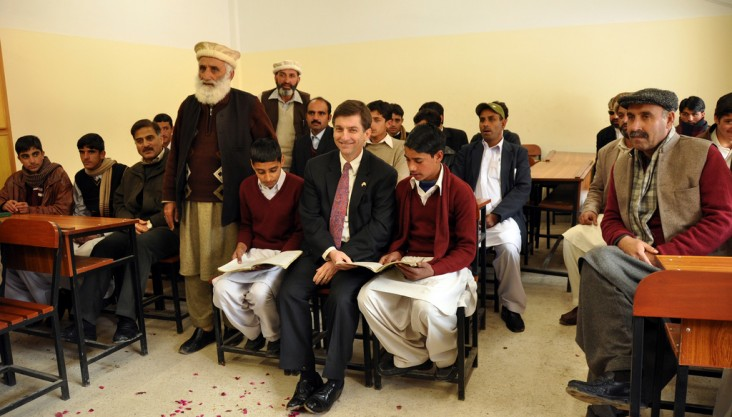 USAID/Pakistan Mission Director Andrew Sisson with students in a classroom at the Government Boys' Higher Secondary School Rera.