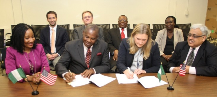 Mr. George Etomi and Power Africa's Lisa Coppe sign the Memorandum of Cooperation between Eko Electricity Distribution Company a