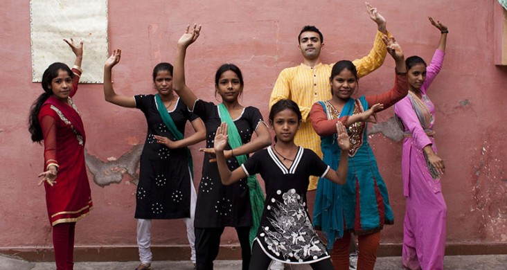 These youth in the Perna community are posing in a traditional bhangra folk dance stance. The dance form allowed the children to gain a sense of autonomy, companionship and group solidarity.