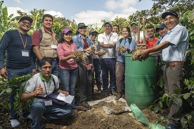 A group of people with compost