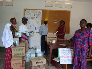 HBC providers (PLHIV) receive medicated soap, water guard and condoms for distribution.
