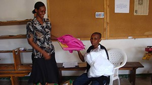 PLHIV at home receive a mosquito net and bed sheet from an HBC provider (PLHIV): Morogoro Municipal.