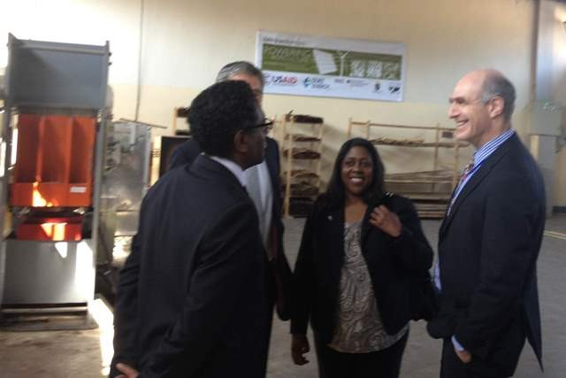 (l-r) African Bamboo's CEO discusses the Powering Agriculture award with USAID representatives.