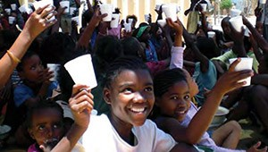 Photo of children in Namibia receiving a daily cup of nutritious yogurt