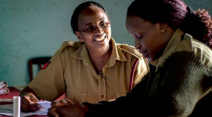 Sgt. Pauline administers an HIV test for a fellow Kenyan Administration Police officer.
