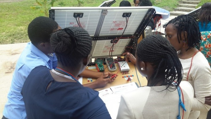 Trainees learning how to troubleshoot PV system components.