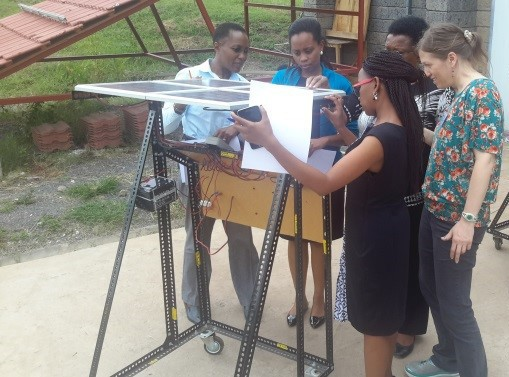 VOCTEC Instructor Carol Weis guides trainees through exercises that help them learn optimal solar panel orientation.