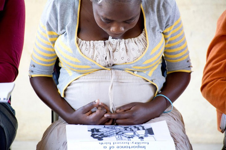 An expectant mother attends antenatal classes taught by a peer facilitator from the community.