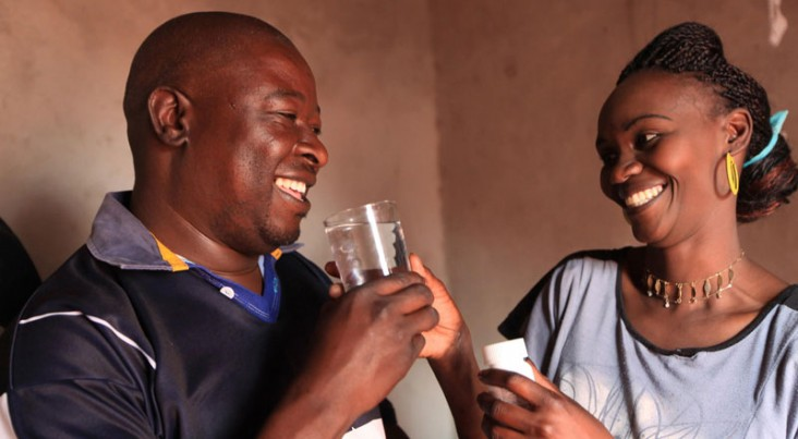 Ishmael and Patricia take antiretroviral drugs at their home in Chitungwiza, Zimbabwe.