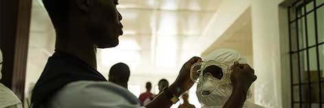 Health care workers put on personal protective equipment (PPE)