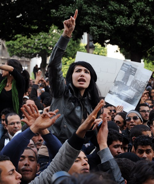 Tunisian demonstrators shout slogans against President Zine el Abidine Ben Ali from a boulevard in Tunis, demanding his immediat