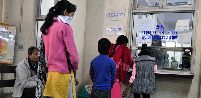 Children wait to get tested for TB