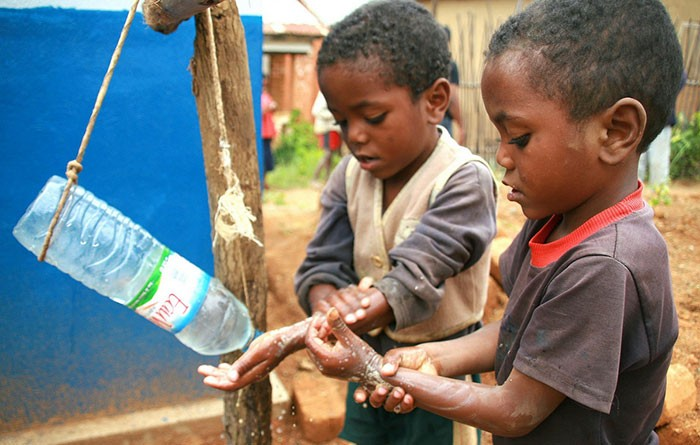 "Children in Madagascar use the low cost, low tech, water-conserving ""tippy tap"" to wash their hands"