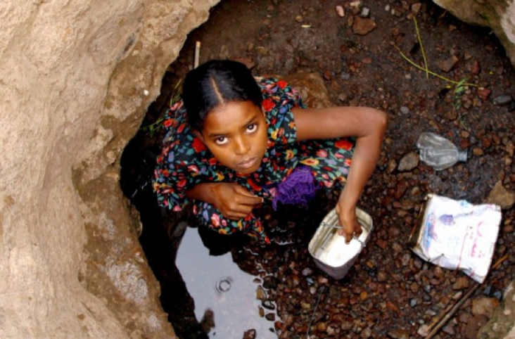 Young girl collecting water in Sagllou prior to USAID WASH project. USAID in Djibouti