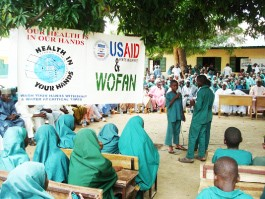 Representatives of USAID and WOFAN distribute hygiene and sanitation materials