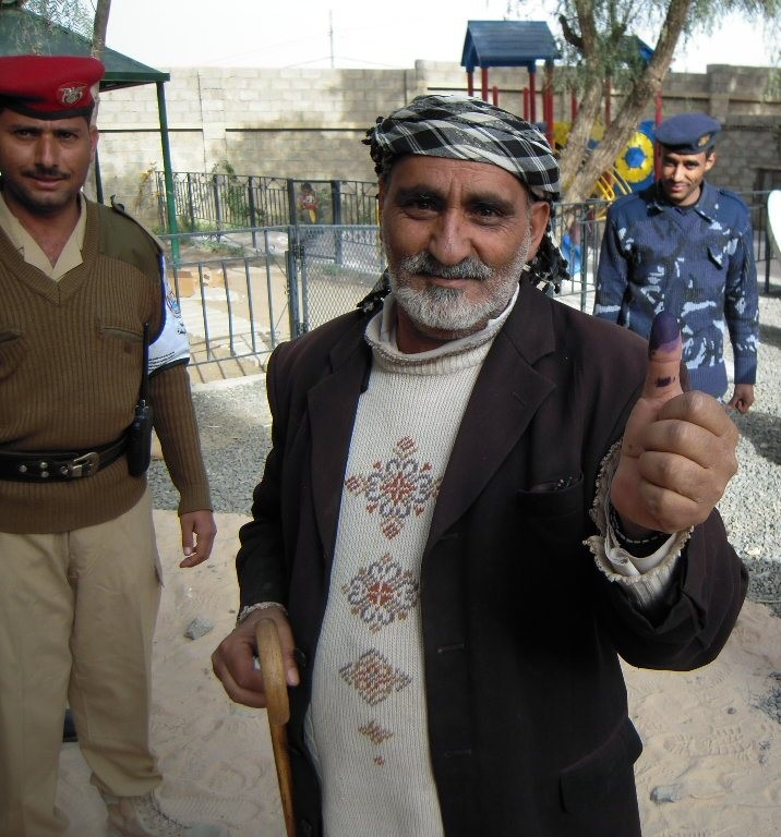 man in Yemen shows ink-stained finger