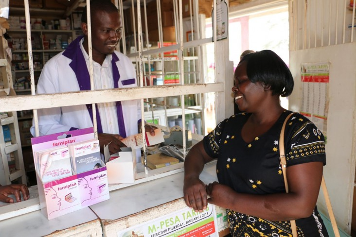 A woman consults with a pharmacist