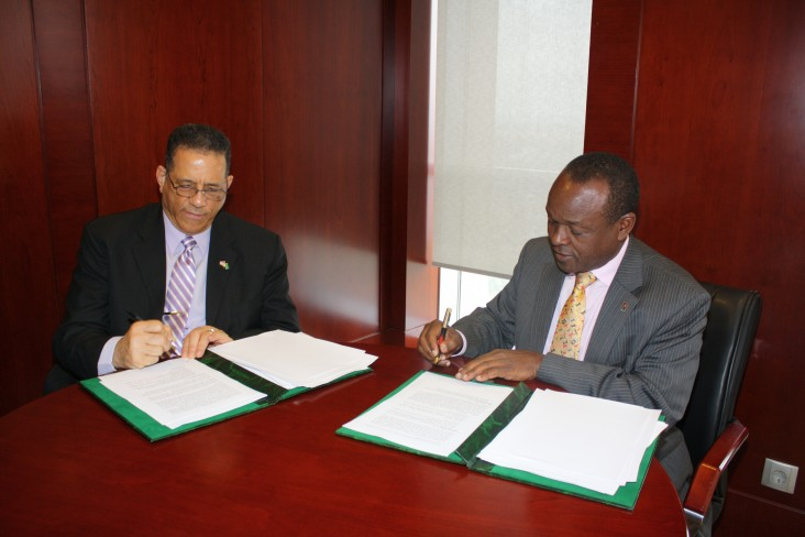 U.S. Ambassador to the AU Michael Battle and African Union Commission Deputy Chairperson Erastus Mwencha renew the agreement