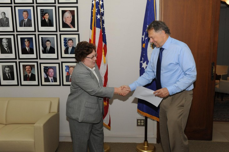 Chargé d'Affaires Richard Jones administering the oath of office for Anne Patterson, USAID Lebanon's new Mission Director.
