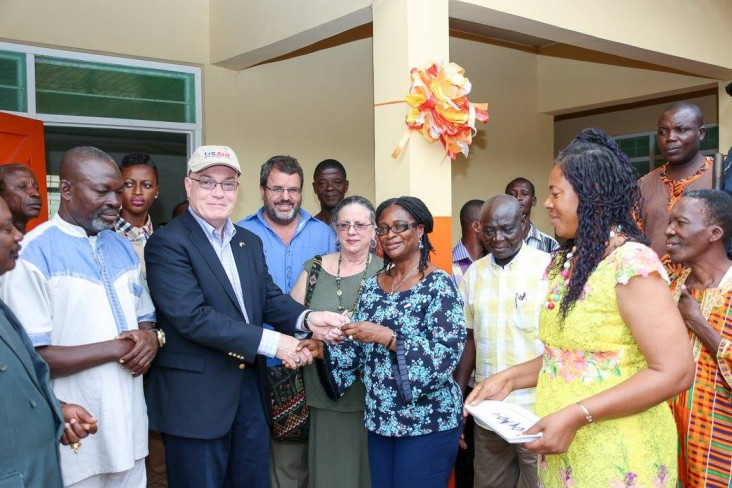 Amb Jackson hands over the keys to the new KG block to the Western Regional Director of Education