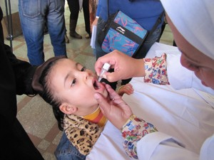 A child receives her polio vaccination in Cairo today.