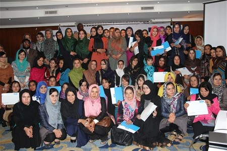 Eighty-six young women professionals celebrate the completion of a six-month Internship Program in Banking and Financial Service