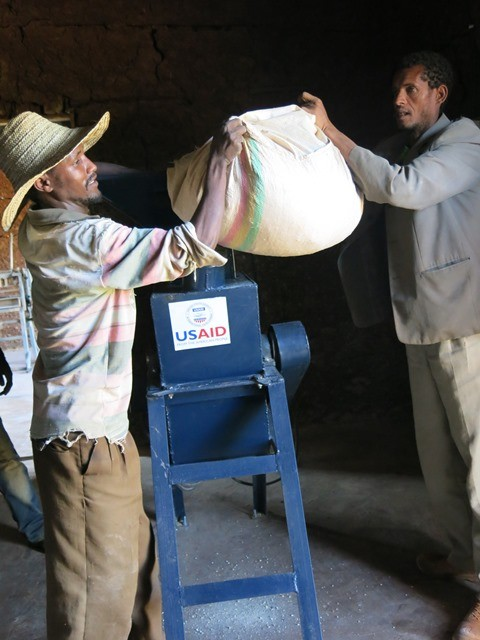 Workers demonstrate how the livestock grinder works. The equipment was provided to Ethio-Feed through a USAID grant.