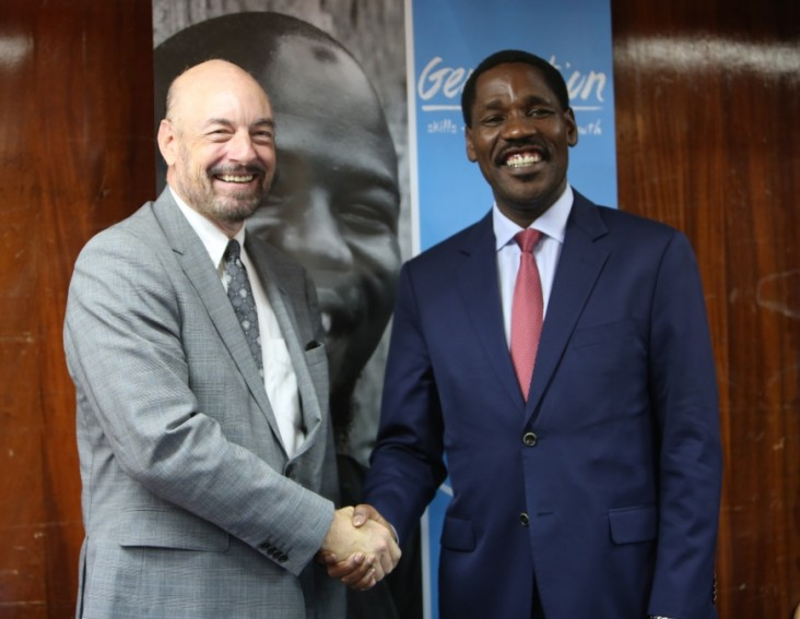USAID Mission Director for Kenya and East Africa Mark Meassick (L) and the Trade and Industry Cabinet Secretary Peter Munya during the Generation Kenya graduation ceremony. USAID supports the initiative which trains youth to learn the skills they need for entry-level jobs.