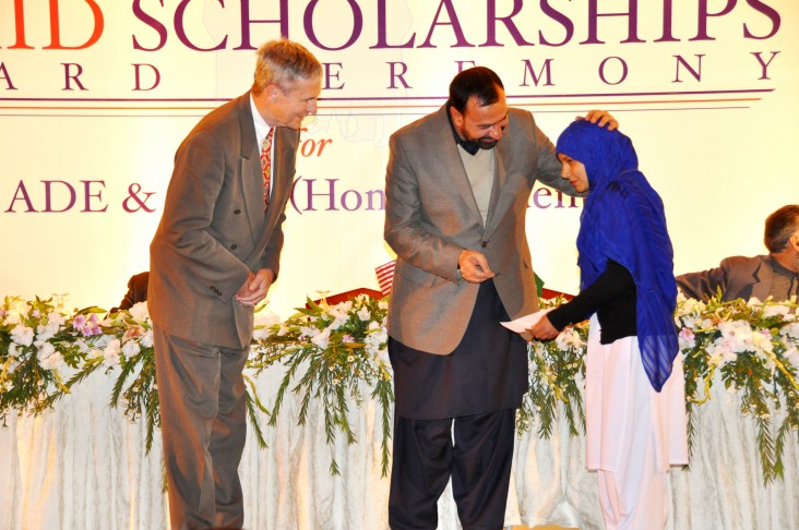 A student beneficiary while receiving her scholarship