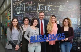 group photo of young women and a man