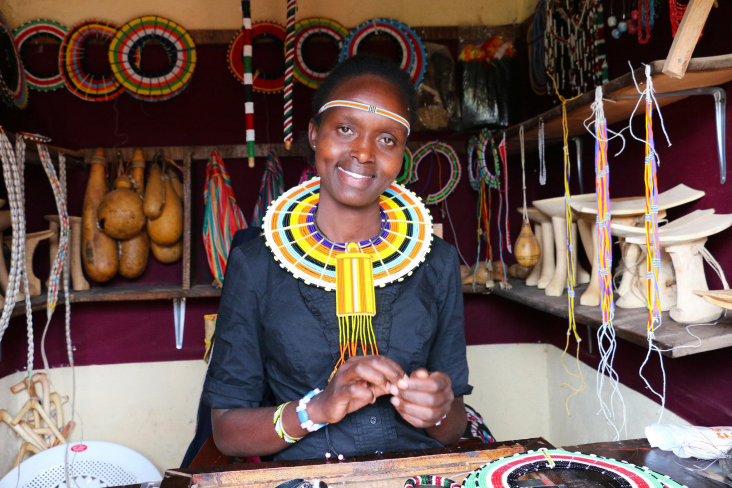 A young kenyan woman entrepreneur in her shop.