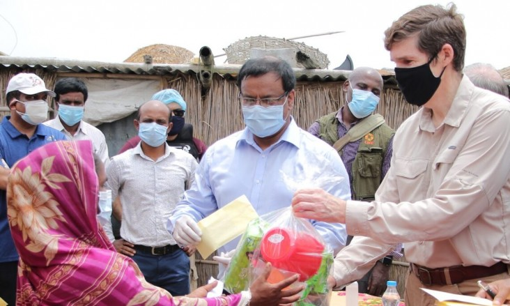 Ambassador Earl Miller meets with families in Madhya Khatiamari village receiving emergency relief from a U.S. government-funded program.