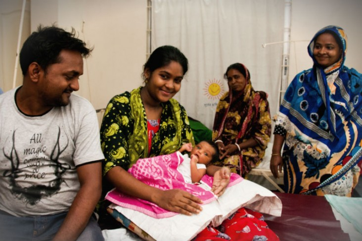 Image of family at Smiling Sun health clinic in Dhaka, Bangladesh