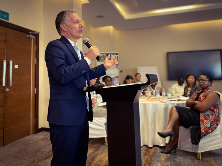 USAID Uganda Mission Director Richard Nelson speaks at the Producer Organizations closeout in Kampala.
