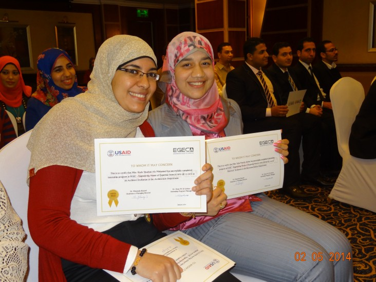Two of the engineers who interned with EGEC proudly display their certificates of completion.