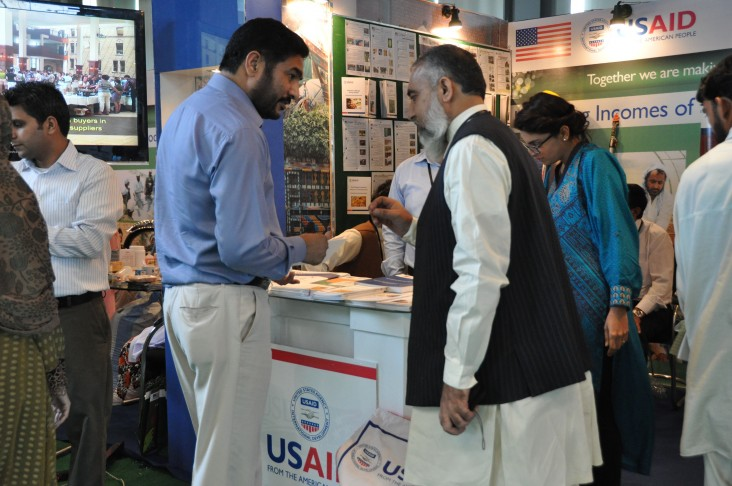 Visitors taking intrest in the USAID projects at the Agriculture Expo