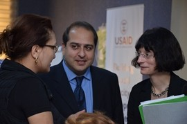 USAID Mission Director converses with a training participant.