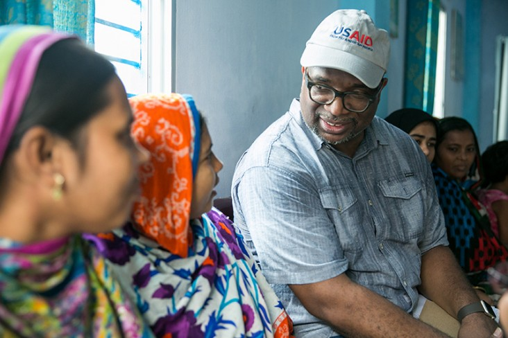 USAID/Bangladesh Mission Director speaks with factory workers at a shrimp and fish processing factory.
