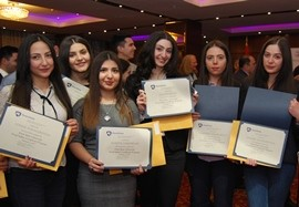 young women with certificates of course completion