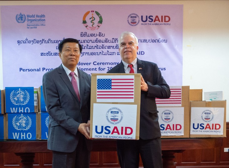 Vice Minister of Health Dr. Phouthone Muoangpak (left) received personal protective equipment from U.S. Ambassador to Lao PDR Dr. Peter M. Haymond (right) at a ceremony in Vientiane today as part of the United States' early assistance to Lao PDR to prepare for any potential spread of the novel coronavirus.