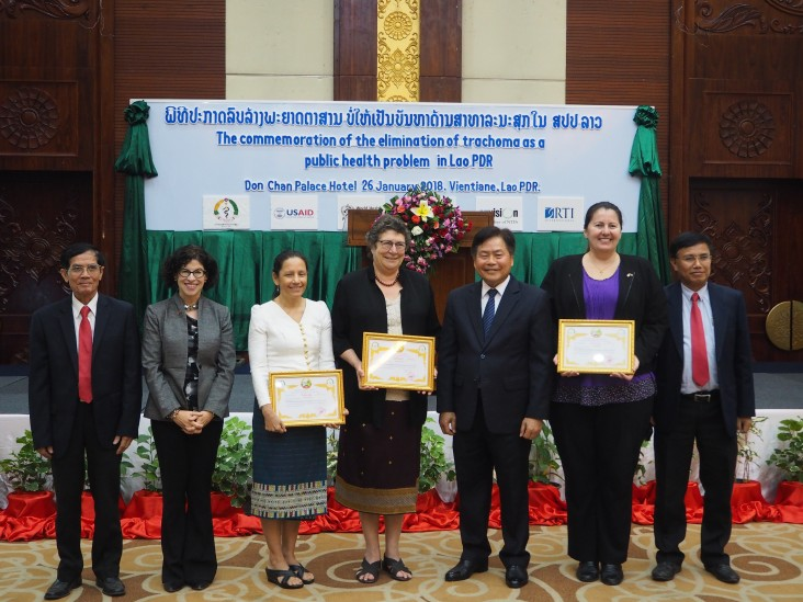 U.S. Ambassador Rena Bitter (Second from left) and Minister of Health Dr. Bounkong Sihavong (fifth from left) celebrate Elimination of Trachoma along with officials from Laos and the international community.