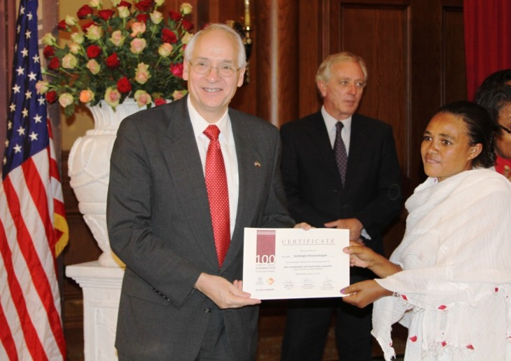 U.S. Ambassador Booth presents certificate to one of the trainees