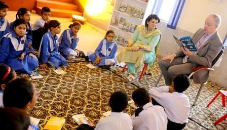 Mission Director John Groarke visited a school in Islamabad and read books with students.