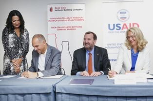USAID and Coca-Cola representatives sign an agreement on partnership