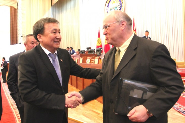 Kyrgyzstan Parliament Speaker Asylbek Jeenbekov thanks USAID Representative Carey Gordon